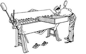 Old-school metal folding machine.