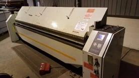 A photo of a metal folding machine